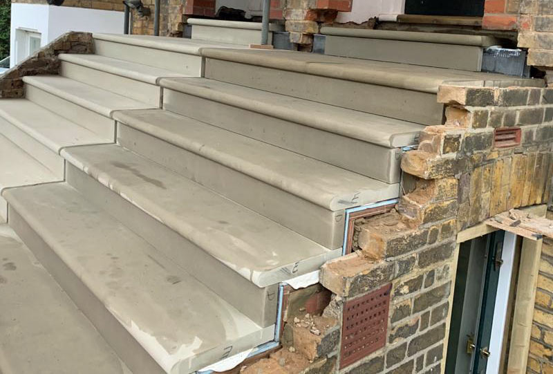 A side view of the waterproofing underneath the steps